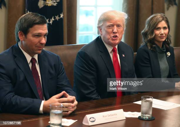 Florida Governor-elect Ron DeSantis sits next to U.S. President Donald Trump and Governor of South Dakota-elect Kristi Noem during a meeting with...