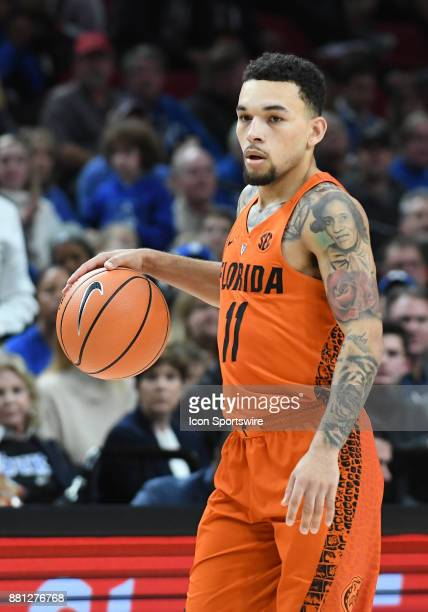 Florida guard Chris Chiozza brings th eball up court in the championship game of the Motion Bracket at the PK80Phil Knight Invitational between the...