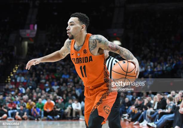 Florida guard Chris Chiozza brings the ball up court in the championship game of the Motion Bracket at the PK80Phil Knight Invitational between the...