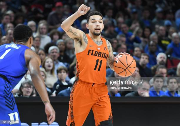Florida guard Chris Chiozza calls out a play in the championship game of the Motion Bracket at the PK80Phil Knight Invitational between the Duke Blue...