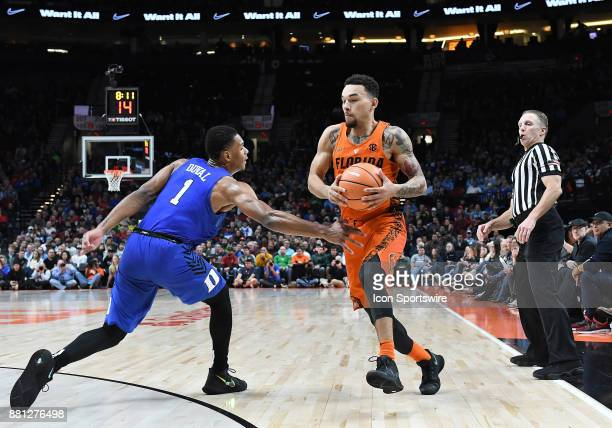 Florida guard Chris Chiozza dribbles by Duke guard Trevon Duval in the championship game of the Motion Bracket at the PK80Phil Knight Invitational...