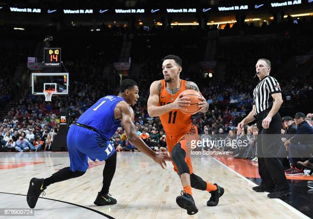 Florida guard Chris Chiozza drives to the basket against Duke guard Trevon Duval in the championship game of the Motion Bracket at the PK80Phil...