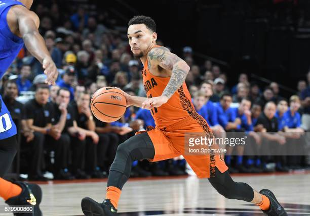 Florida guard Chris Chiozza drives to the basket in the championship game of the Motion Bracket at the PK80Phil Knight Invitational between the Duke...