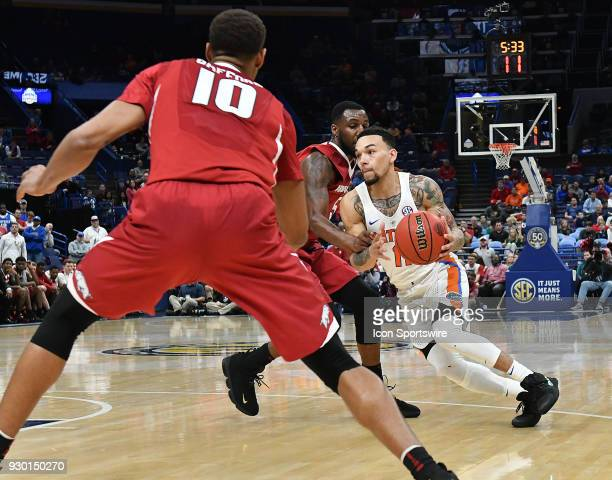 Florida guard Chris Chiozza drives to the basket late in the game during a Southeastern Conference Basketball Tournament game between Florida and...