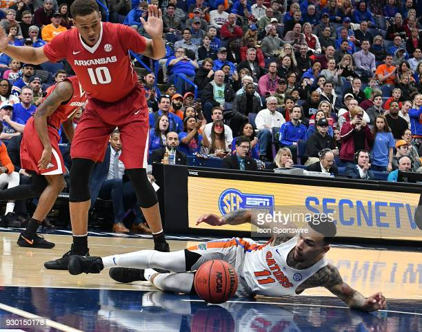 Florida guard Chris Chiozza falls to the court while going after a loose ball during a Southeastern Conference Basketball Tournament game between...