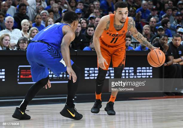 Florida guard Chris Chiozza looks to dribble against Duke guard Trevon Duval in the championship game of the Motion Bracket at the PK80Phil Knight...