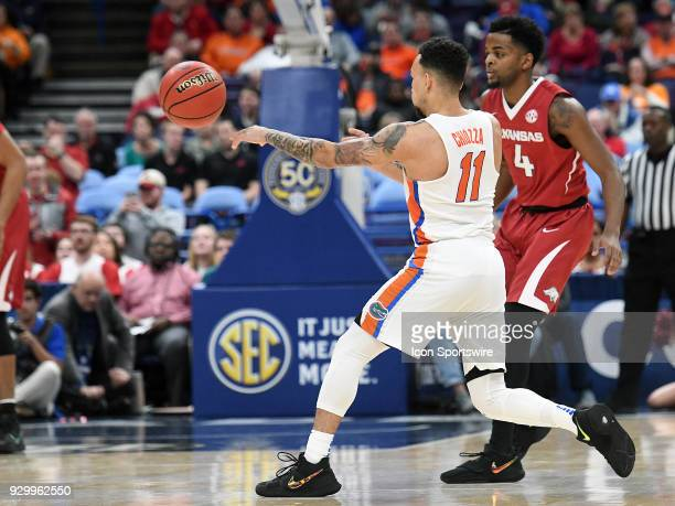 Florida guard Chris Chiozza passes the ball during a Southeastern Conference Basketball Tournament game between Florida and Arkansas on March 09 at...