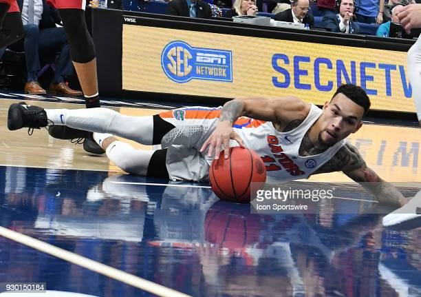 Florida guard Chris Chiozza with the loose ball he recovered during a Southeastern Conference Basketball Tournament game between Florida and Arkansas...