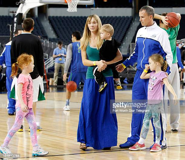Florida Gulf Coast head coach Andy Enfield and his wife Amanda along with daughters Aila and Lily and son Marcum step onto the court for a photo...