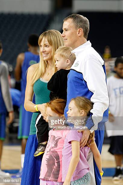 Florida Gulf Coast head coach Andy Enfield and his wife Amanda join daughters Aila and Lily and son Marcum for a photo during practice at Cowboys...