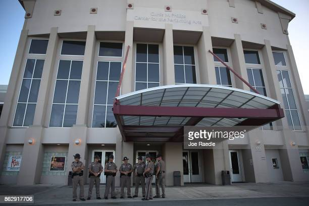 Florida Highway Patrol officers stand outside the Curtis M Phillips Center for the Performing Arts as they prepare the venue for Thursday's scheduled...