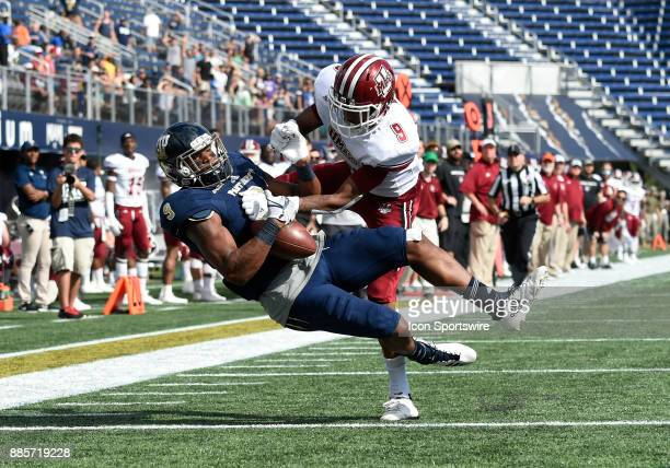 Florida International University wide receiver Bryce Singleton catches a touchdown pass against UMass defensive back Isaiah Rodgers during an NCAA...