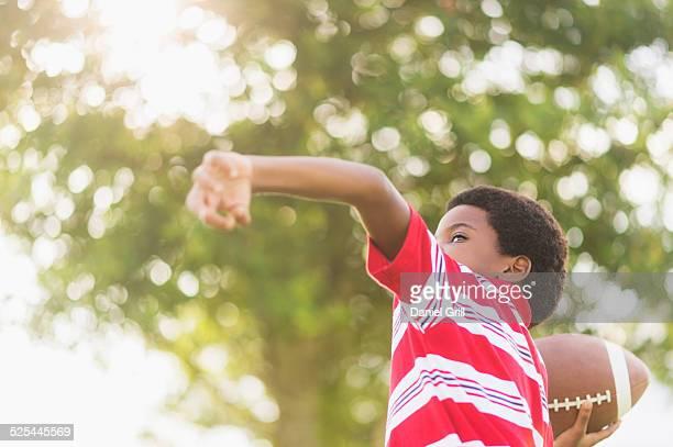 usa, florida, jupiter, boy (6-7 ) playing football - throwing stock photos and pictures