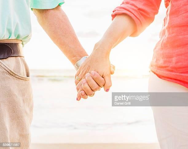 USA, Florida, Jupiter, Couple holding hands on beach