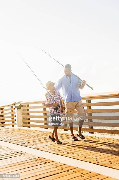 USA, Florida, Jupiter, Father and son (10-11) fishing