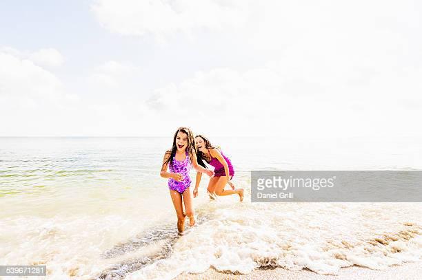 USA, Florida, Jupiter, Girl (6-7) and her mom enjoying themselves on beach