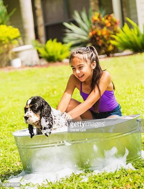USA, Florida, Jupiter, Girl (8-9 ) bathing dog
