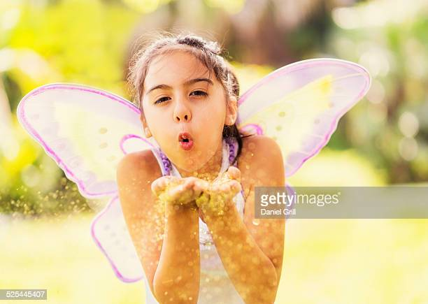 USA, Florida, Jupiter, Girl (8-9 ) blowing fairy dust