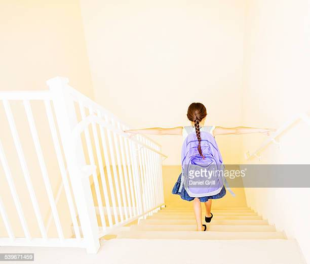 usa, florida, jupiter, girl (6-7) with backpack walking down stairs at home - children only stock pictures, royalty-free photos & images