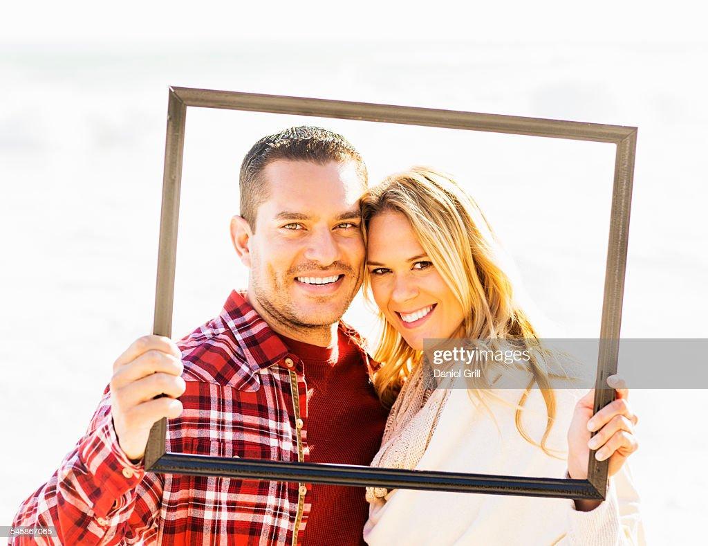 Usa Florida Jupiter Portrait Of Couple Holding Frame Stock Photo ...