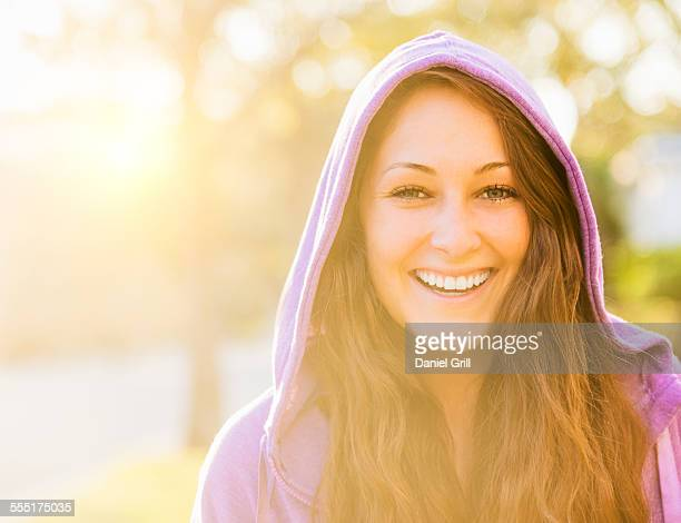 usa, florida, jupiter, portrait of smiling woman in hoodie - purple shirt stock photos and pictures