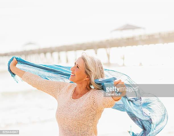 usa, florida, jupiter, senior woman on beach - shawl stock photos and pictures