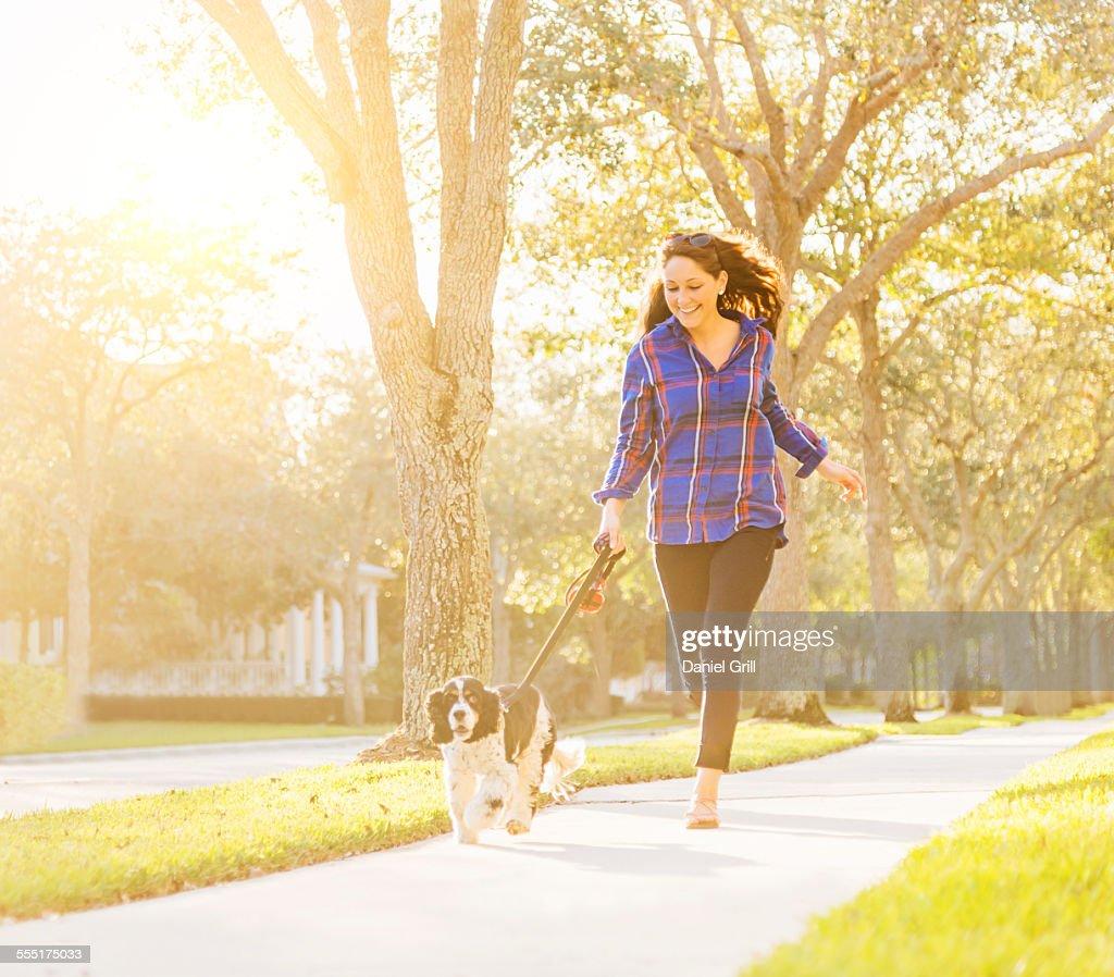USA, Florida, Jupiter, Woman running with her dog : Stock Photo