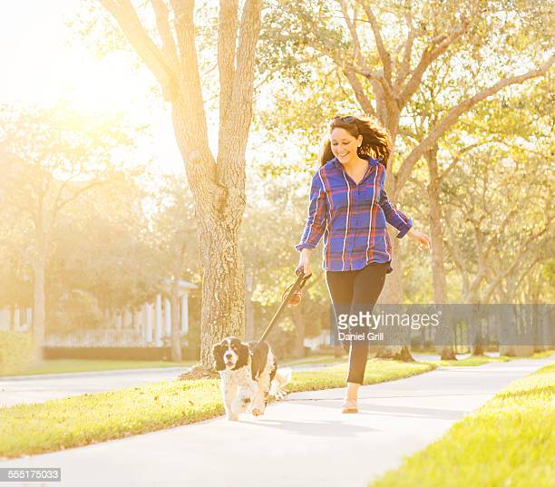 USA, Florida, Jupiter, Woman running with her dog