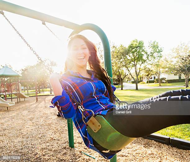USA, Florida, Jupiter, Woman swinging in playground