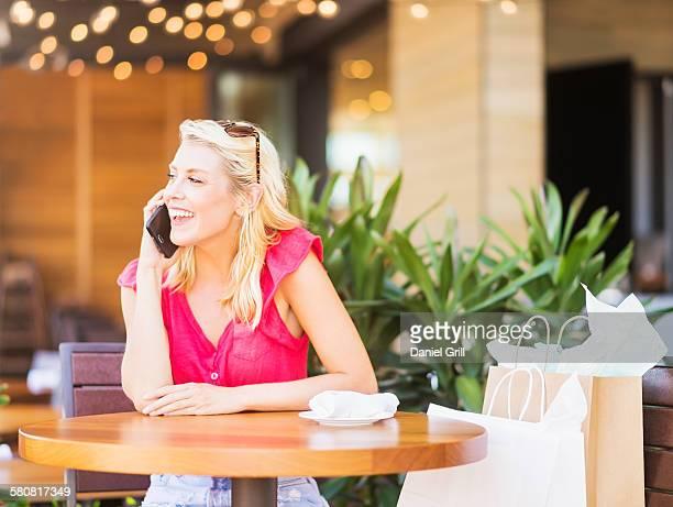 USA, Florida, Jupiter, Woman talking on phone in cafe