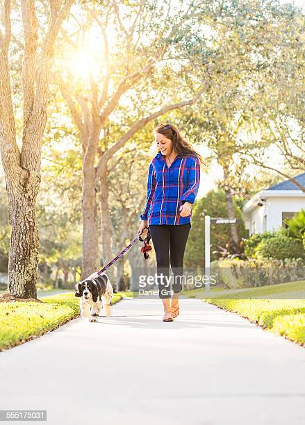 USA, Florida, Jupiter, Woman walking her dog