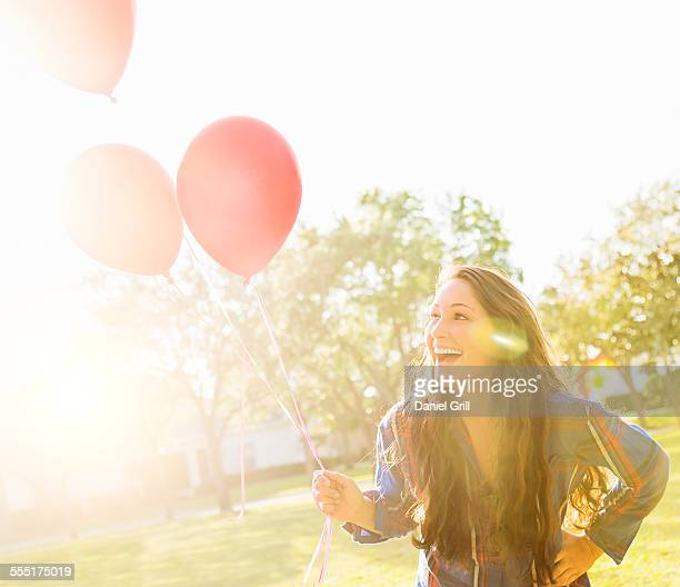 USA, Florida, Jupiter, Woman with balloons outdoors