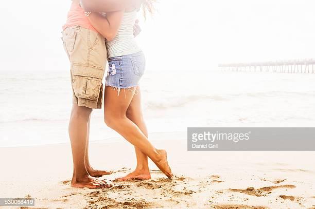 USA, Florida, Jupiter, Young couple embracing on beach