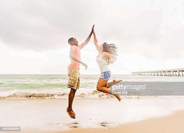 USA, Florida, Jupiter, Young couple playing on beach