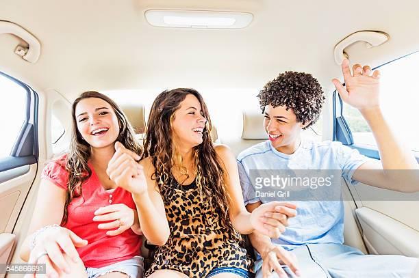 USA, Florida, Jupiter, Young people and teenager (14-15) having fun in car