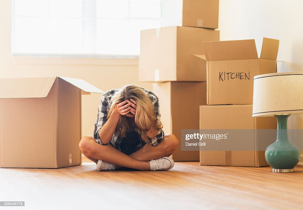 USA, Florida, Jupiter, Young woman during moving into new house : Stock Photo