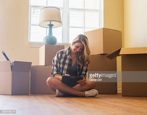 USA, Florida, Jupiter, Young woman in her new house