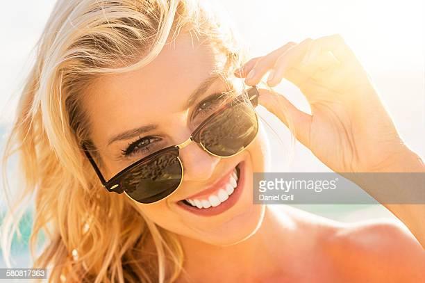 USA, Florida, Jupiter, Young woman wearing sunglasses