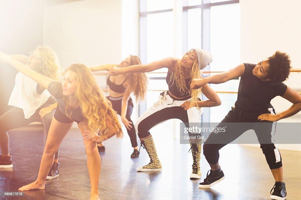 USA, Florida, Jupiter, Young women dancing in dance studio : Stock Photo
