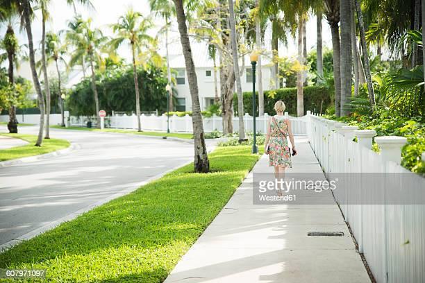 USA, Florida, Key West, woman walking on sidewalk