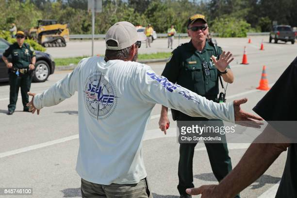 Florida Keys resident argues with law enforcement officers who are preventing people from returing to their homes following Hurricane Irma September...