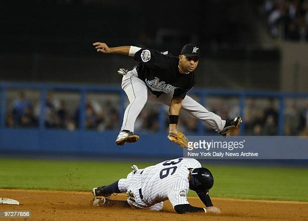 Florida Marlins' Alex Gonzalez gets New York Yankees' Nick Johnson out at second base but accidentally kicks him in the head during a double play in...