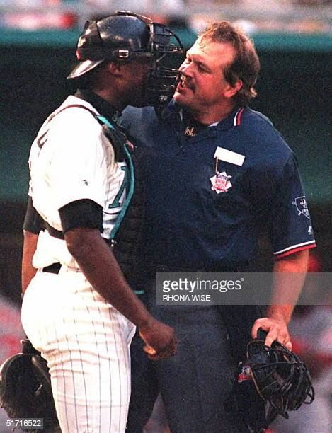 Florida Marlin's catcher Charles Johnson argues a call with home plate umpire Wally Bell after Bell called Cincinnati Red's second baseman Jeff...