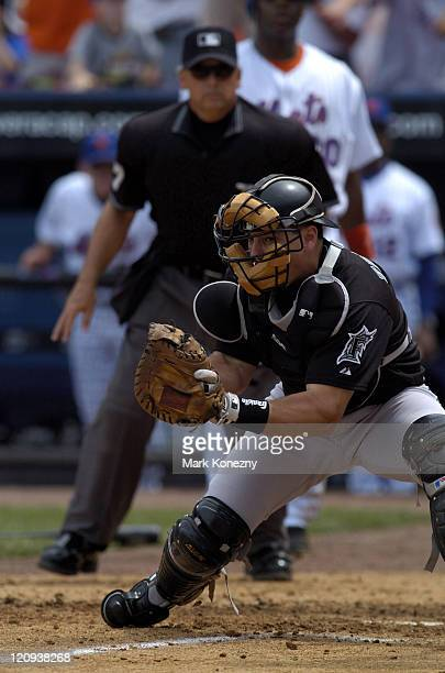 Florida Marlins catcher Matt Treanor attempts to make a tag at the plate during a game against the New York Mets at Shea Stadium New York NY on July...