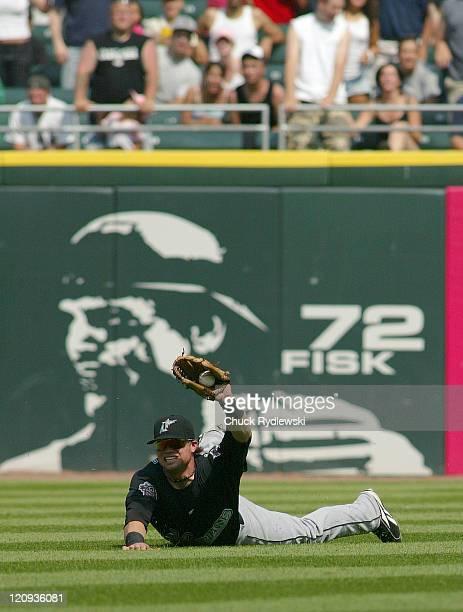 Florida Marlins' Center Fielder Brett Carroll shows the 2nd base umpire the ball after robbing Juan Uribe of a 2run single during their Interleague...