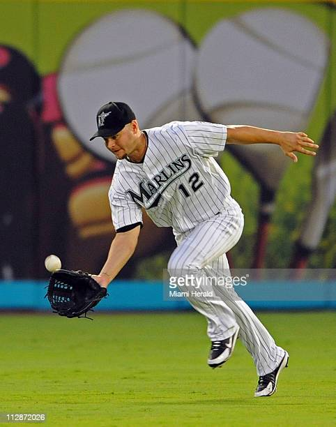 Florida Marlins centerfielder Cody Ross catches a sinking fly ball from Atlanta Braves' Kelly Johnson at Dolphin Stadium in Miami Florida Sunday July...