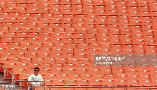 Florida Marlins fan has a section of Miami's Joe Robbie Stadium all to himself as he attends the 27 July doubleheader between the Florida Marlins and...