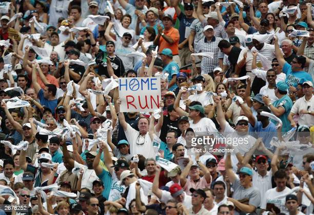 Florida Marlins fans cheer after catcher Pudge Rodriguez of the Florida Marlins hit a home run in the first inning against the San Francisco Giants...
