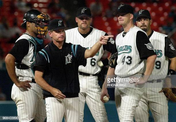 Florida Marlins manager John Boles stands on the mound with catcher Ramon Castro shortstop Andy Fox pitcher AJ Burnett and third baseman Mike Lowell...