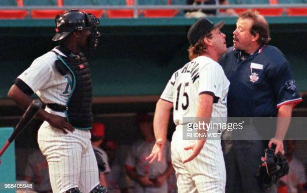 Florida Marlin's Manager Rene Lachemann gestures back to catcher Charles Johnson as he argues a call with home plate umpire Wally Bell in Miami...